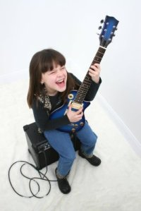 bigstockphoto_Girl__Years_Playing_Electri_17397