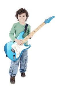 bigstockphoto_Boy_Whit_Electric_Guitar_2851735