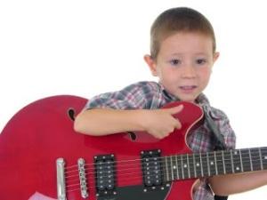 bigstockphoto_Guitar_Boy_302189