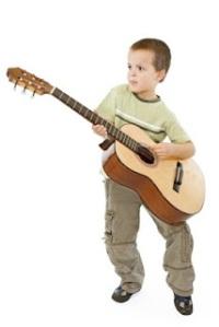 bigstockphoto_Guitar_Kid_4011232