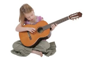 bigstockphoto_Young_Girl_With_Guitar_2339814